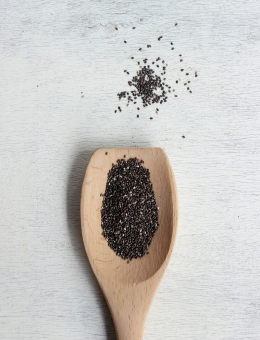 A wooden spoon of Organic Chia Seeds