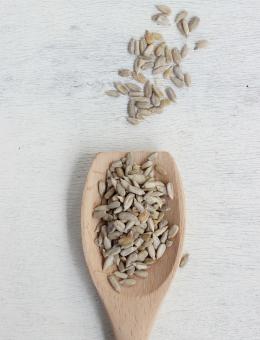 A wooden spoon of Raw Sun flower Seeds