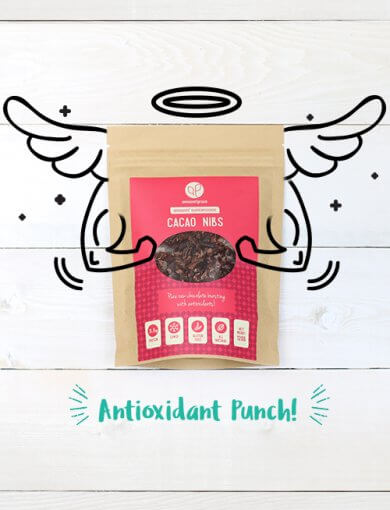 A packet of Amazin' Graze's cacao nibs with superhero illustrations of wings, arms, and a halo