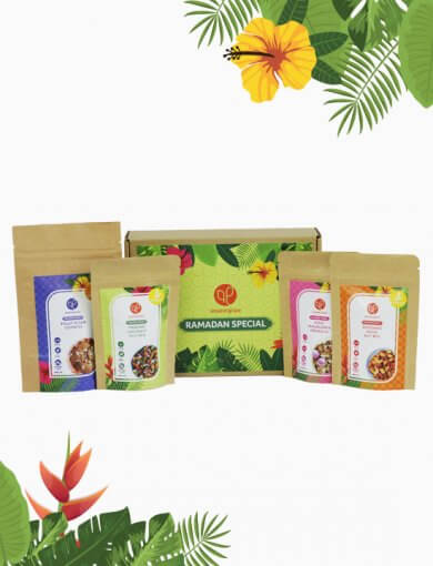 Ramadan Mini Gift Box containing 40 g packets of Rose Macadamia Granola, Pandan Coconut Nut Mix, Rendang Spice Nut Mix, and Pulut Hitam Cookies