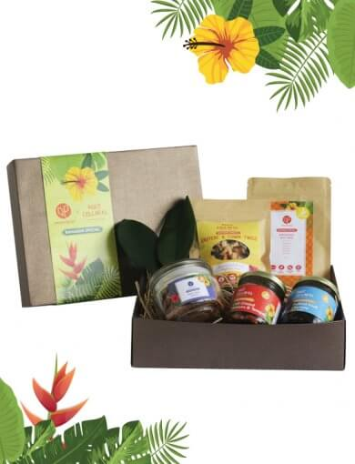 Ramadan snacks gift set by Amazin' Graze and RCKL containing Rendang Spice Nut Mix, Date, Orange & Ginger Cookies, Sea Salt & Cardamom Crackers, Pickled Fruit Chutney, and Cumin & Gruyere Twigs