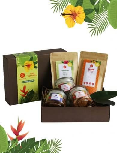 Ramadan healthy snacks gift box featuring Rose Macadamia Granola, Pandan Coconut Nut Mix, Pulut Hitam Cookies, Chili Glazed Peanuts & Tempeh, and Gingerflower Shortbread