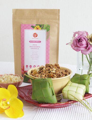 Amazin' Graze Rose Macadamia Granola with ketupat, flowers, and a bowl of macadamias