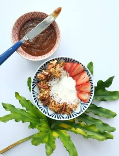 Bowl of Coconut Kaya Granola with a small bowl of kaya and bread knife