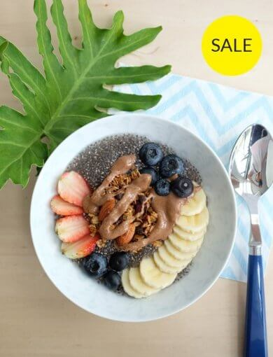 Wake Me Up Chia Pudding - top down image of chia pudding bowl topped with granola, nut butter, and fresh fruit