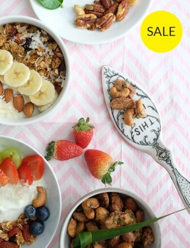 Go Nuts for Coconuts - Top shot of bowls containing Amazin' products in Go Nuts for Coconuts Bundle - Coconut Curry Lime Nut Mix, Salted Gula Melaka Granola, Blueberry Goji Coconut Granola, and Pandan Coconut Nut Mix