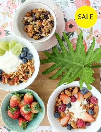 Berry Burst - top shot of bowls of Amazin' products in Berry Burst bundle: Blueberry Goji Coconut Granola, Berry-licious Trail Mix, and Pink Raspberry Granola